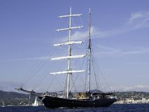 Swan. Classic sailing vessel Swan entering the bay of St-Tropez on engine Royalty Free Stock Image