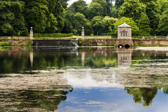 A Swan, an Arch and Romantic Waters on an English Estate Royalty Free Stock Photo