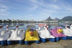 Swan Boats Lagoa Rio de Janeiro Brazil Scenic Skyline. Scenic skyline view with swan and duck boats on Lagoa lagoon in Rio de Janeiro Brazil with Ipanema and Stock Image