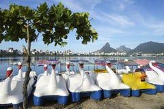 Swan Boats Lagoa Rio de Janeiro Brazil Scenic Skyline. Scenic skyline view with row of swan and duck boats dry docked on Lagoa lagoon in Rio de Janeiro Brazil Royalty Free Stock Photo