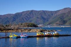 Swan boats on the lake in Kawaguchiko, Japan Stock Photo
