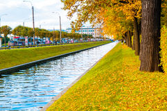 Swan Canal and autumn park with golden autumn trees. Autumn city landscape of Saint Petersburg, Russia Stock Image