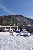 Swan fun boats on lake Chuzenji, lake shore in win Stock Photos