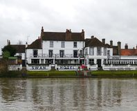 The Swan Hotel A 16th Century hotel in Staines Surrey Uk. The Swan sits serenely on the Thames, serving up blissful river views, fine food, delicious drinks and Stock Image