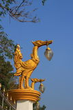 Swan lamp. At the fence of temple royalty free stock photo