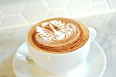 Swan latte art on cappuccino. A cup of cappuccino with swan latte art on top as decoration Stock Photo