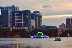 Swan paddle boats for rent at Lake Eola Park and colorful fountain on beatiful sunset stock photos