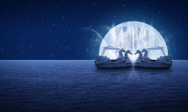 Swan pedal boat on fantasy sea sky fountain and moon night time Royalty Free Stock Photography