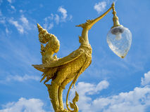 Swan-shaped lamp with golden sky and clouds Royalty Free Stock Photography