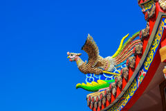 Swan statue on roof of chinese temple with blue sky Stock Images