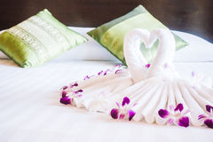 Swan towel on bed Royalty Free Stock Image