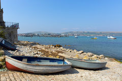 Swanage Dorset England UK with rowing boats and the bay by the harbour Stock Image