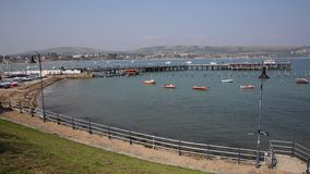 Swanage harbour and jetty Dorset England UK with sea and coast stock footage