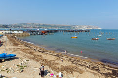 Swanage harbour and jetty Dorset England UK with sea and coast Royalty Free Stock Photography