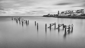 Swanage Old Pier. A view of the Old Pier at Swanage.  This is a long exposure image taken from the new pier Royalty Free Stock Photography
