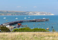 Swanage pier jetty and bay Dorset England UK Royalty Free Stock Photography