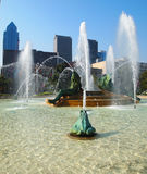 Swann Memorial Fountain in Logan Circle. Swann Memorial Fountain with Skyscrapers in the background - Philadelphia, PA Royalty Free Stock Image