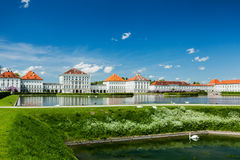 Swans in fountain in front of the Nymphenburg Palace. Munich, Ba Royalty Free Stock Image