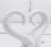 Swans made from towels on the bed Royalty Free Stock Image