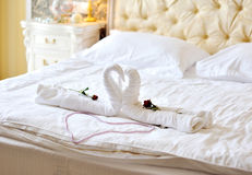 Swans out of towels on the bed Stock Photo