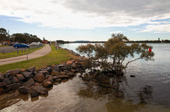 Swansea Australia Town Lakeside Sidewalk. SWANSEA, NEW SOUTH WALES, AUSTRALIA, JULY 11 2017: Sidewalk with parked cars along the lake shore of this popular Royalty Free Stock Photos