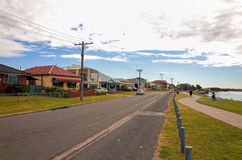 Swansea Australia Town Street with Houses and Apartment building. SWANSEA, NEW SOUTH WALES, AUSTRALIA, JULY 11 2017: Street scene with houses along the lake Royalty Free Stock Photography