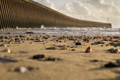 Swansea Bay Jetty. Swansea Bay, sea shells on beach and jetty wall Royalty Free Stock Photography