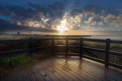 Swansea boardwalk sunrise. Sunrise at Swansea Bay showing the West Pier and the boardwalk Royalty Free Stock Photos