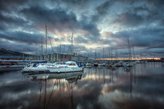 Swansea Marina Reflections. Cloud reflections in the early morning on the River Tawe and Swansea Marina Stock Images