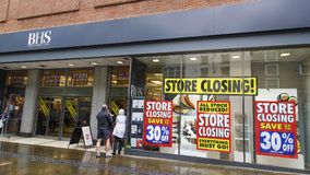 British Home Stores going out of business. Swansea, UK: June 19, 2016: Shoppers enter a department store that is closing down. British Home Stores is a British Royalty Free Stock Image
