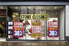 British Home Stores going out of business. Swansea, UK: June 19, 2016: Shoppers enter a department store that is closing down. British Home Stores is a British Stock Photography