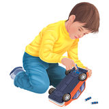 Swap the batteries. A boy replace his toy car batteries Stock Images