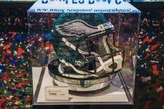Swarovski Eagles helmet on sale in NFL Experience in Times Square, New York, USA. NEW YORK, USA - MAY 28, 2018: Swarovski Eagles helmet on sale in NFL royalty free stock photo