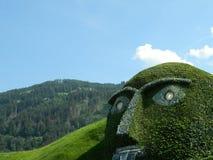 Swarovski green man of legend near Innsbruck, Austria. Swarovski green man of legend near Innsbruck, Austria, at the main crystal factory Royalty Free Stock Photography