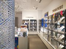 Swarovski shop in a mall. Showcases with jewelry on one side and the other royalty free stock photo