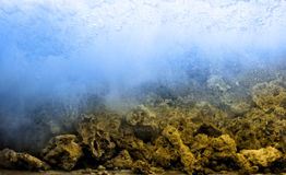 Swash underwater. With the stones Royalty Free Stock Image