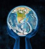 Swasiland op aarde in handen Royalty-vrije Stock Foto's