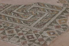 The Swastika: an ancient cosmic symbol. The meander is a simplified labyrinth. Roman mosaic located in archaeological site in the city of Plovdiv, Bulgaria stock photos