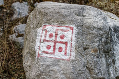 Swastika sign on grey stone at Thangu and Chopta valley in winter in Lachen. North Sikkim, India Royalty Free Stock Image