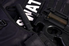 SWAT armor and rifle. Armor suit SWAT unit and rifle with silenser Stock Photography