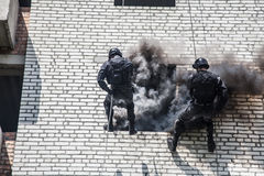 SWAT assault operation. Spec ops police officer SWAT during assault operation Stock Photos