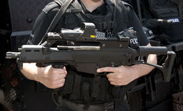 POLICE SWAT HK G36 assault rifle. Hampshire, England, June 2012. Police firearms officer armed with Heckler and Koch G36C assault rifle with Eotech aiming device Royalty Free Stock Image