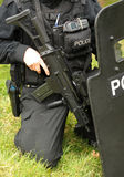 Police SWAT marksman with ballistic shield. Police firearms officer armed with an Heckler and Koch G36C assault rifle. Real Police SWAT Stock Images