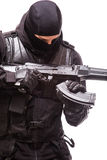 SWAT officer with assault rifle in black uniform isolated on white Stock Photo
