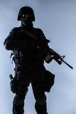 SWAT officer backlit Royalty Free Stock Images