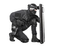 SWAT officer with ballistic shield Royalty Free Stock Photos
