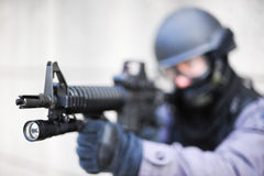 SWAT Officer with Gun. A SWAT police officer looking down the barrel of a gun Royalty Free Stock Photos