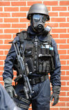 Police SWAT officer with machine gun. A British police SWAT officer in gas mask Armed with Mp5 machine gun Real police UK U.K. England English British Britain Stock Images