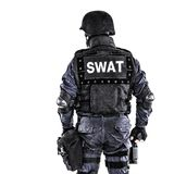 SWAT officer. Special weapons and tactics SWAT team officer shot from behind Royalty Free Stock Photo