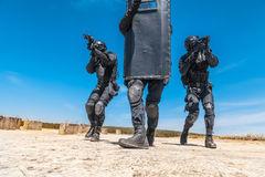 SWAT officers with ballistic shield Stock Images